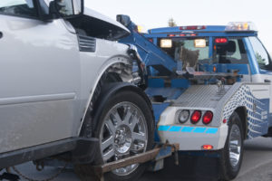 DAMAGED VEHICLE BEING REPOSSESSED